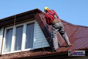 roofer repairing red metal roof