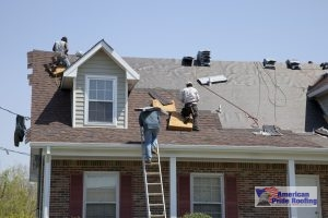 roofers replace storm damaged roof