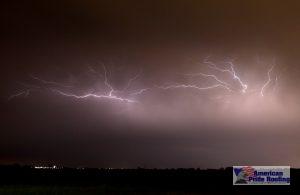 lightning strikes against purple stormy sky