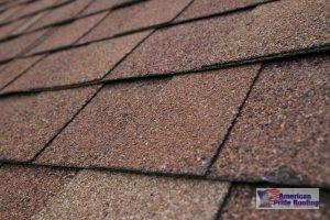 close up of brown asphalt shingle
