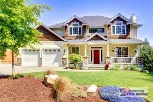 house with a shingle roof and cedar siding