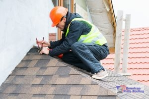 roofer installing shingles on a roof