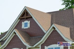 shingles on sloped roof with gabled windows