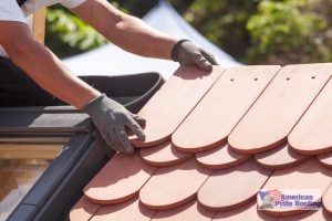 roofer installs tile roof