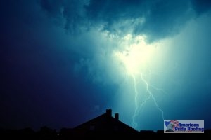 blue thundercloud and lightning over house