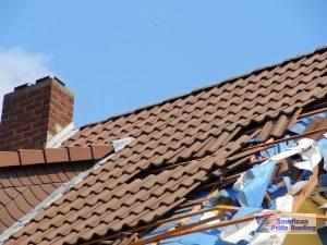 storm damaged tile roof