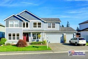 shingle roof on blue suburban home
